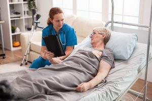 Female doctor in nursing home using tablet computer